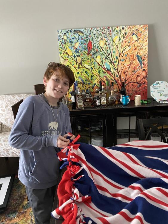 Eli Ostroff making a blanket